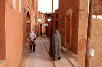 Local women ambling through the streets of Abyaneh, Iran
