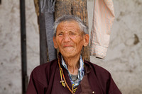 The creases on the face of an elderly Ladakhi man at Shey Palace, Ladakh, India