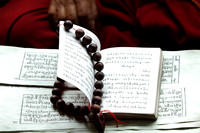 The Holy Buddhist scriptures in front of a monk at Shey Palace, Ladakh