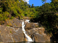 The gorgeous Meenmutty waterfall that flows through the dense tropical forests of the Western Ghats
