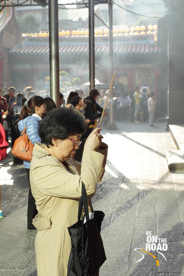 In deep prayer at Longshan Temple, Taipei, Taiwan