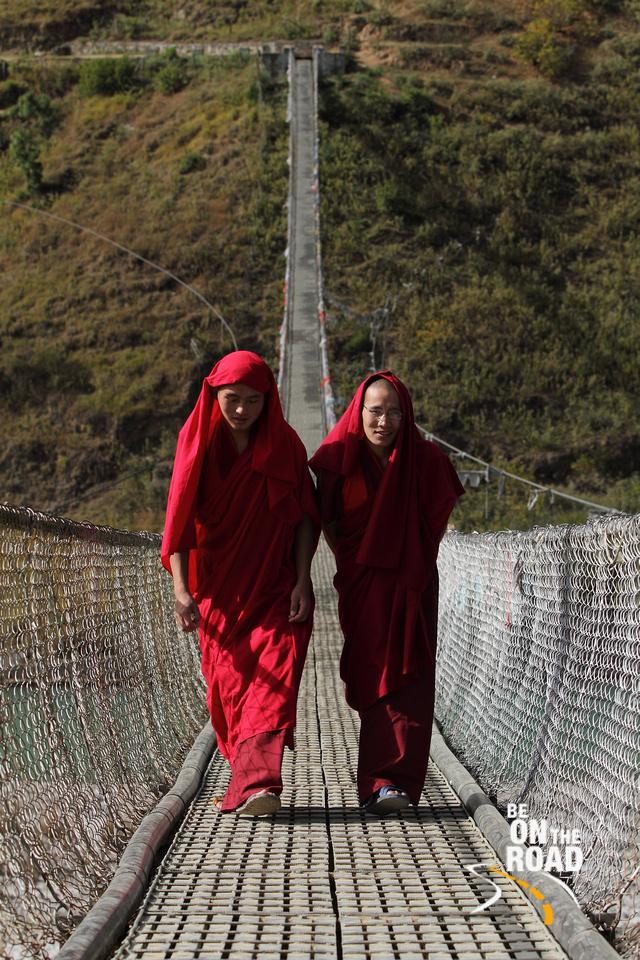 Monks on Punakha's Suspension Bridge
