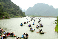 Maze of boats get ready to explore the caves around the Tam Coc river, Vietnam