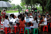 Learning to play musical instruments from street musicians at Taman Suropati, jakarta