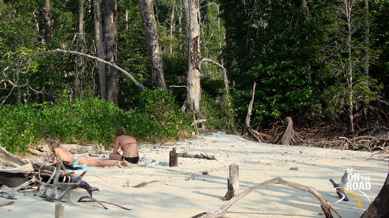 Tourists relaxing at the secluded Elephant Beach