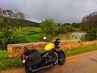 My bike, the lush environment and the dark monsoon clouds