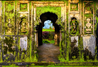 Beautiful moss covered carvings inside Nalknad palace, Coorg