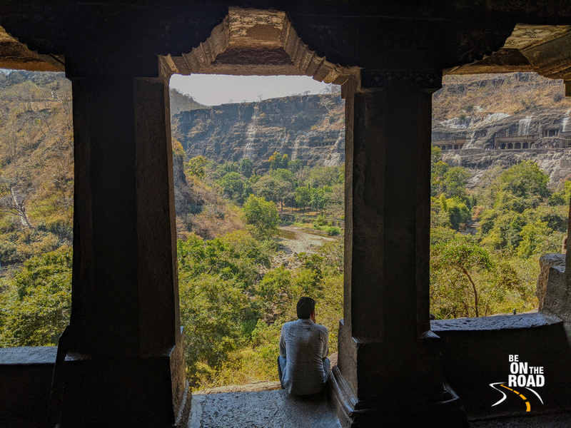 Admiring the Ajanta landscape while sitting on the steps of one of its caves
