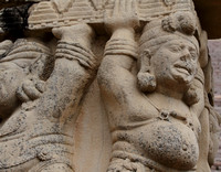 The mythological creatures holding the load of the toranas at Sanchi Stupa
