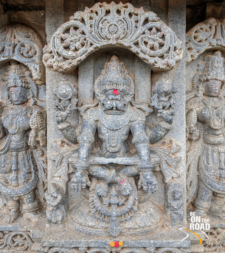Yoganarasimha with two consorts and Garuda and Prahalada below - Lakshmi Narasimha Temple, Nuggehalli