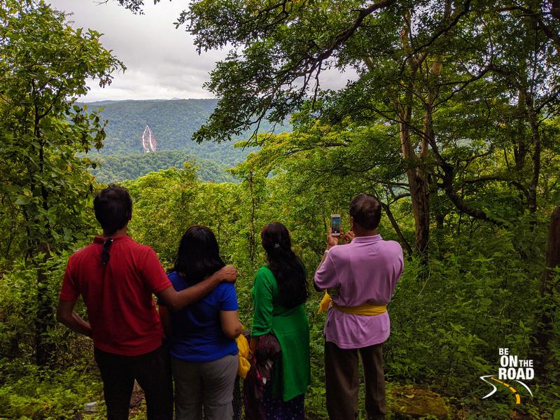 Enjoying the lush green waterfall view near Magod Falls, Karnataka