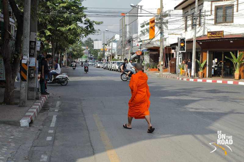 Buddhist Monk crossing a road in Chiang Mai, Thailand