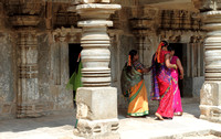 Women in colurful sarees exploring the richness of the Somnathpur Keshava Temple