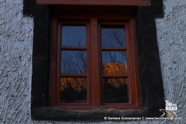 Reflection of the Himalayan mountains on the Hemis Monastery window