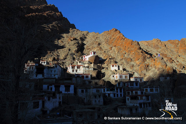The sun sets over the houses of the monks at Hemis
