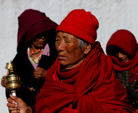 An Elderly Bhutanese Woman offering prayers at Thimphu, Bhutan