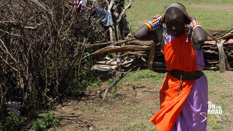 Maasai woman carrying firewood from the forest to the village