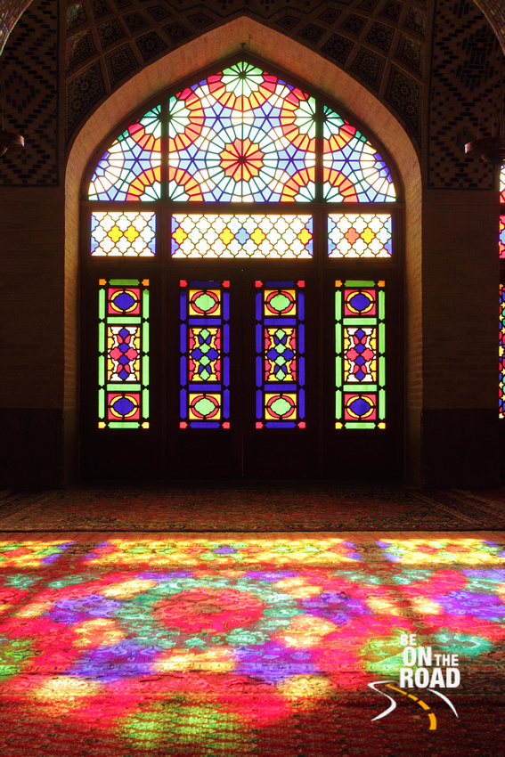 Colourful window and its colourful reflection at Nasir-Al Mosque, Shiraz, Iran
