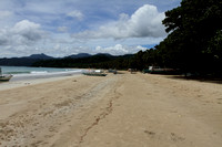 Sabang Beach surrounded by forests and mountains, Philippines
