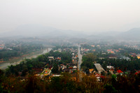 Hazy Luang Prabang view from the top of Mount Funsi