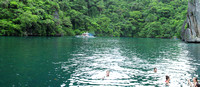 Swimming in the rain in a gorgeous lagoon near El Nido, Philippines