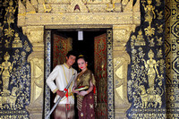 Newly Wed Laos couple pose at Wat Xieng Thong, Luang Prabang, Laos