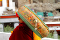 Monk carrying traditional music instrument at Hemis Monastery, Ladakh