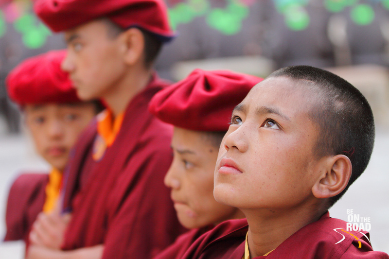 Young Monk looks skywards during Hemis Monastery Festival, Ladakh