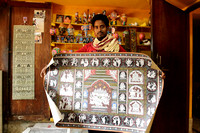 Raghurajpur artisan showing his father's famous Patta Chitra painting