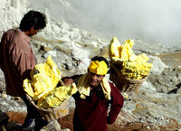 A Kawah Ijen Sulphur Miner with traditional headgear