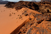 Red sand dunes of Wadi Rum amidst the mountains