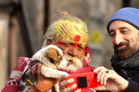 All eyes on the phone - a sadhu baba and puppy moment, Orchha