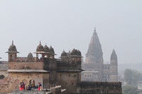 Orchha fort and Chatrubhuj temple opening up through the fog