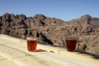 A cup of tea and soaking in the spectacular view of the Petra Archaeological park, Jordan