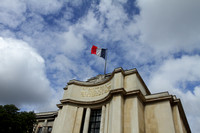 French flag flying high at government building in Paris