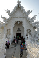 Entering the white temple at Chiang Rai, Thailand