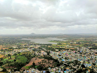 Monsoon clouds, Byrasagara lake and Gudibande town as seen from the top of Gudibande Fort