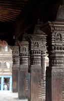 Intricated carved wooden pillars at Patan's Krishna Temple