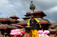 The beautiful temples at Kathmandu Durbar Square and a young boy on stilts