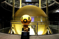 The Mascot in front of the actual Taipei 101 Damper