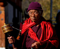 Old man from Bhutan offering prayers