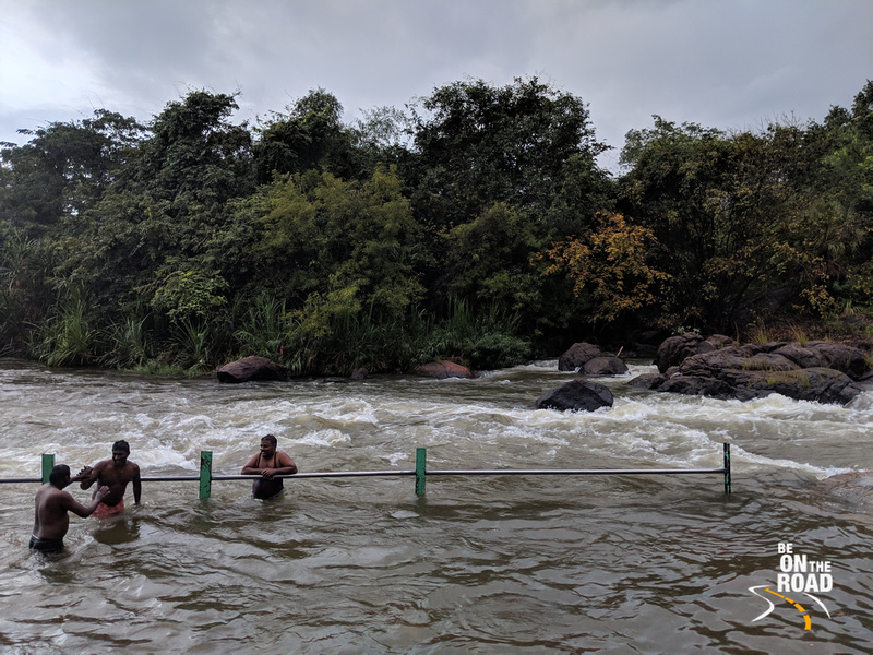 Enjoying a dip in the Thamarabharani river at Papanasam