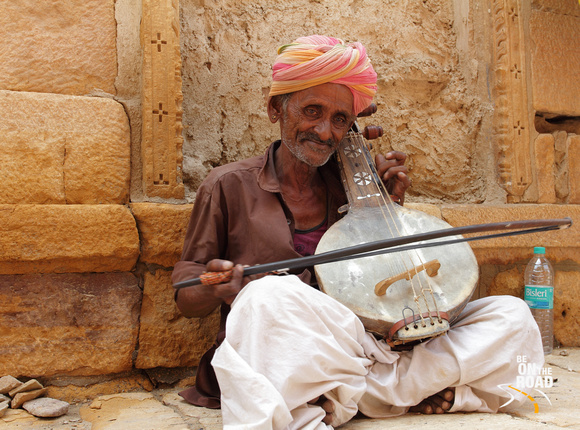 Local musician playing his music inside Jaisalmer Fort