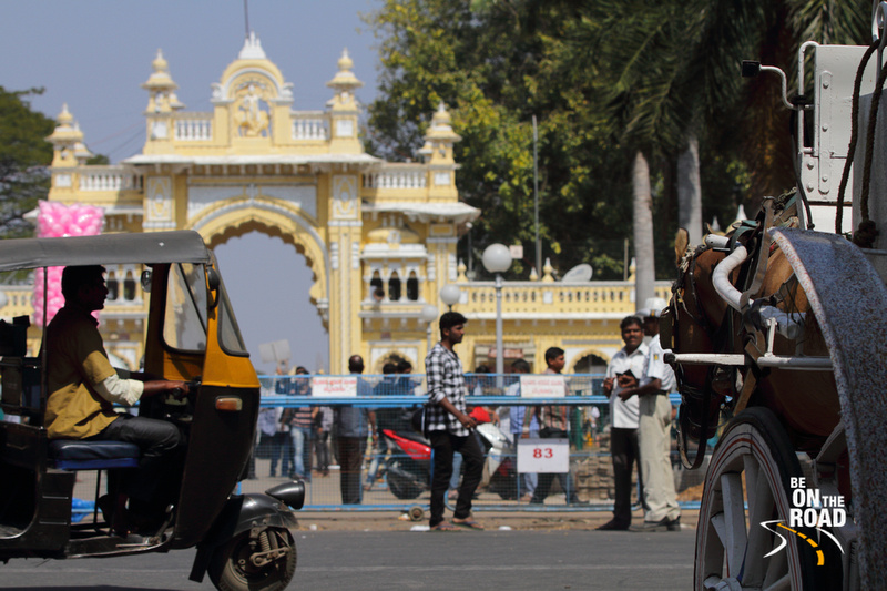 Horse cart, Autorickshaw and street life in front of Mysore Palace, Karnataka, India