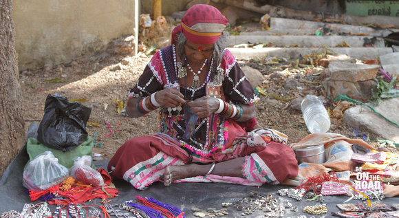 Tribal woman and her trinket shop on the streets of Hampi, Karnataka, India