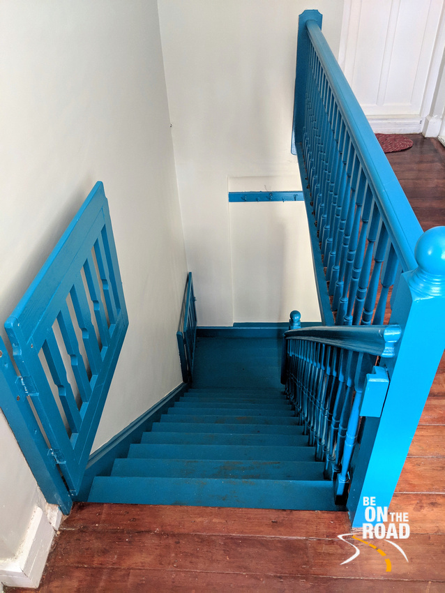 The blue wooden staircase of Gravityville, Ooty
