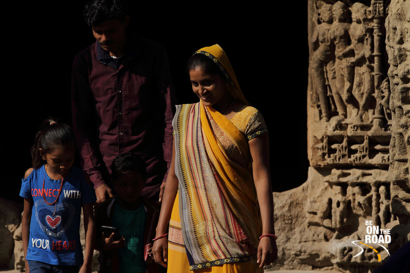 Local woman dressed in colorful saree visits Modhera Sun Temple with her family