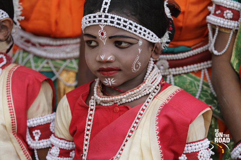 An inkling of a smile on the face of a young Goti Pua dancer