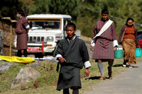 Bhutanese Local Man walks down the streets of Trongsa, Bhutan