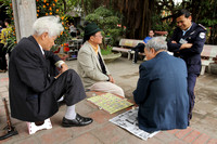 Vietnamese Chinese Checkers being played on the streets of Hanoi, Vietnam